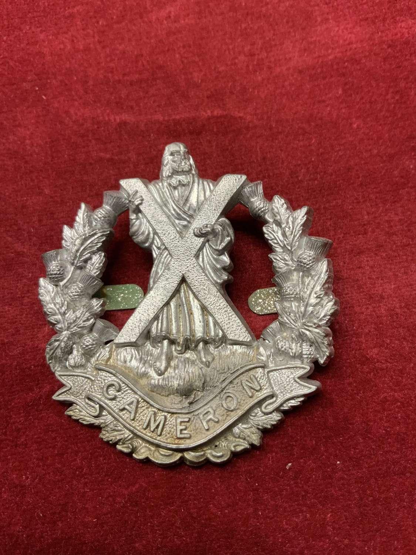Cameron Highlanders Plastic Cap Badge Silver in colour