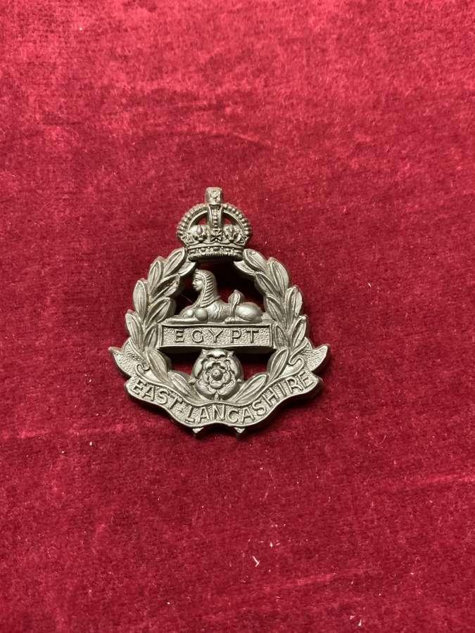 East Lancashire Regiment Silver Coloured Plastic Cap Badge