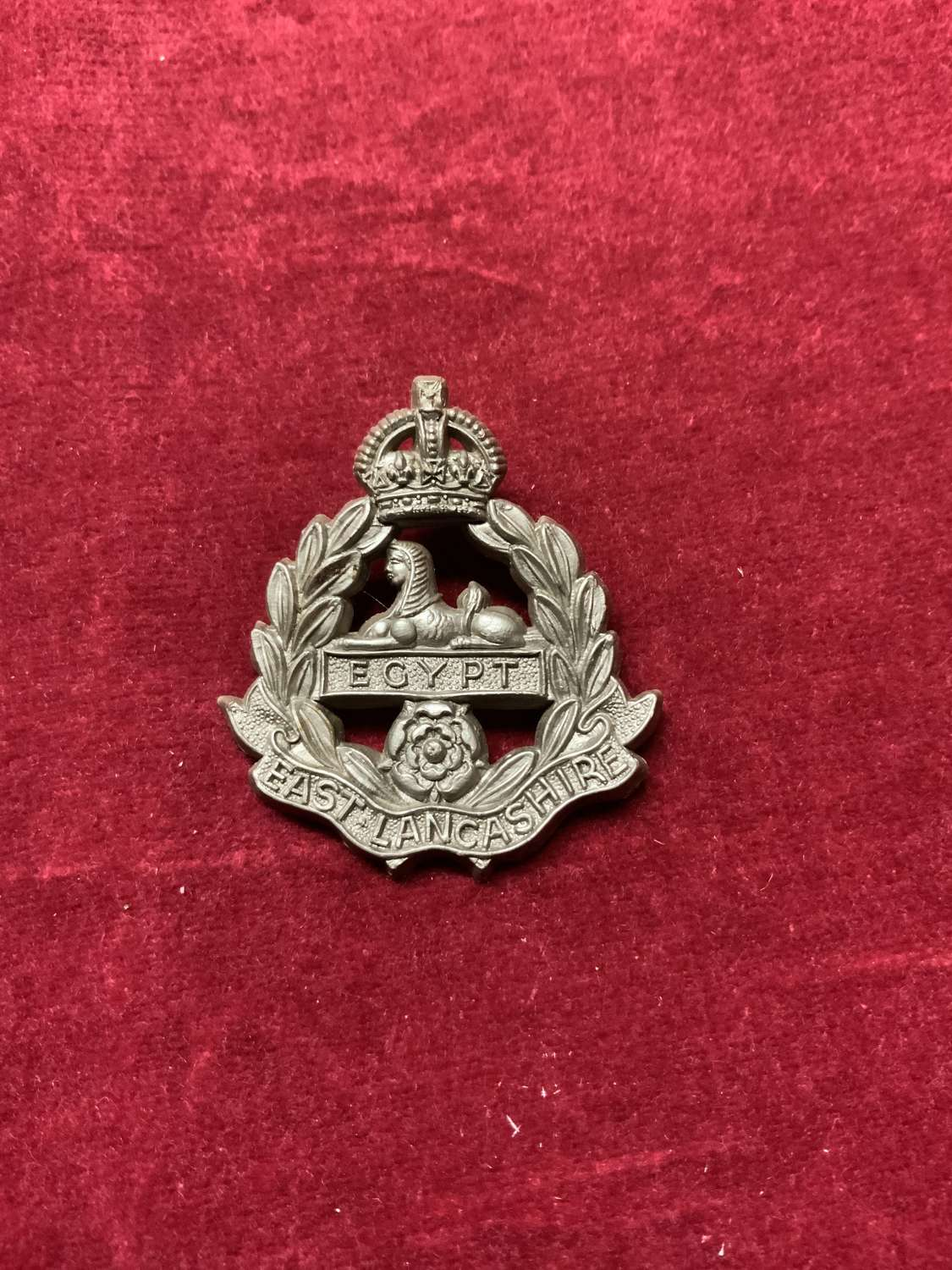 East Lancashire Regiment Silver Coloured Plastic Cap Badge