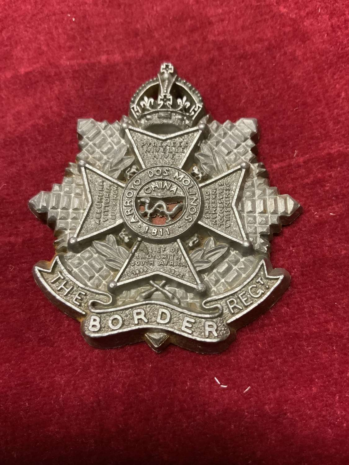 The Border Regiment Silver Coloured Plastic Cap Badge