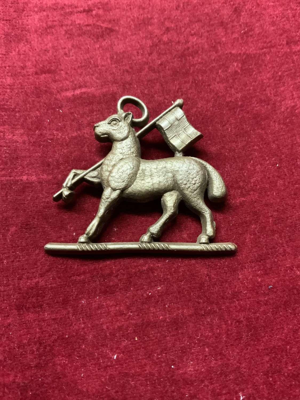 The Queens Royal West Surrey Regiment Silver Coloured Plastic Cap Badg