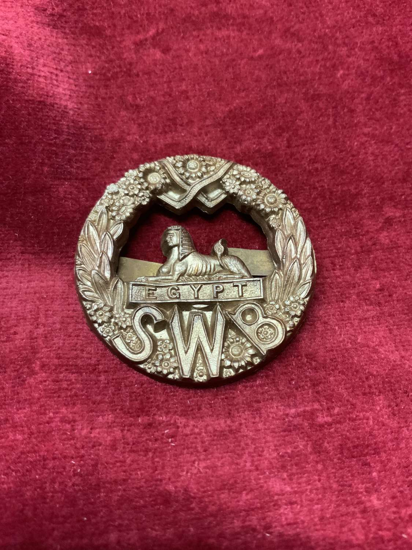 South Wales Borderers Bronze Plastic Cap Badge