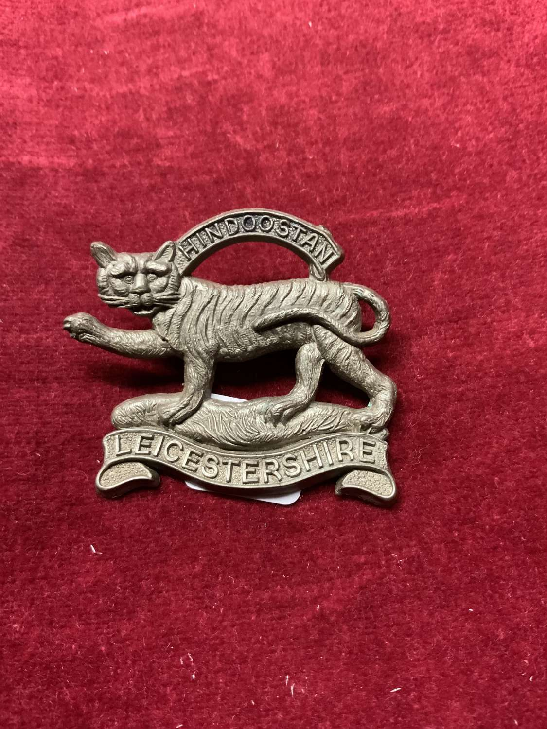 Leicestershire Regiment Silver Coloured Plastic Cap Badge