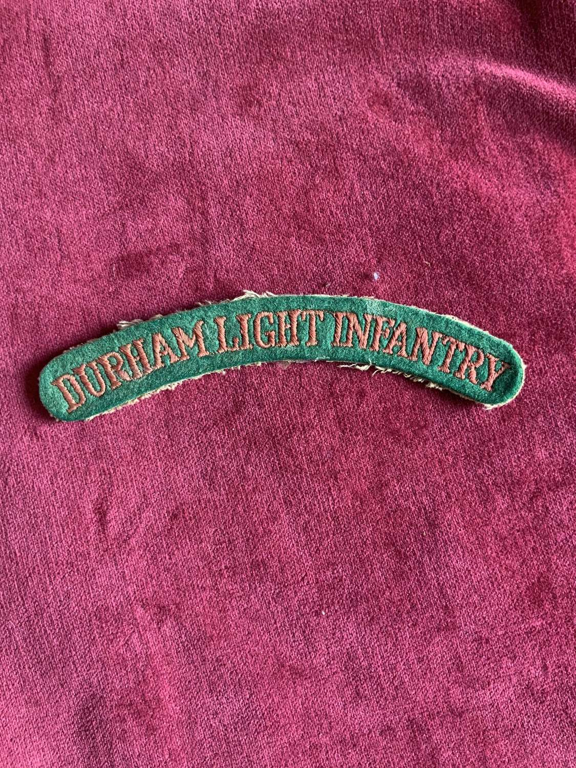 Durham Light Infantry, Pink On Green Early Shoulder Title